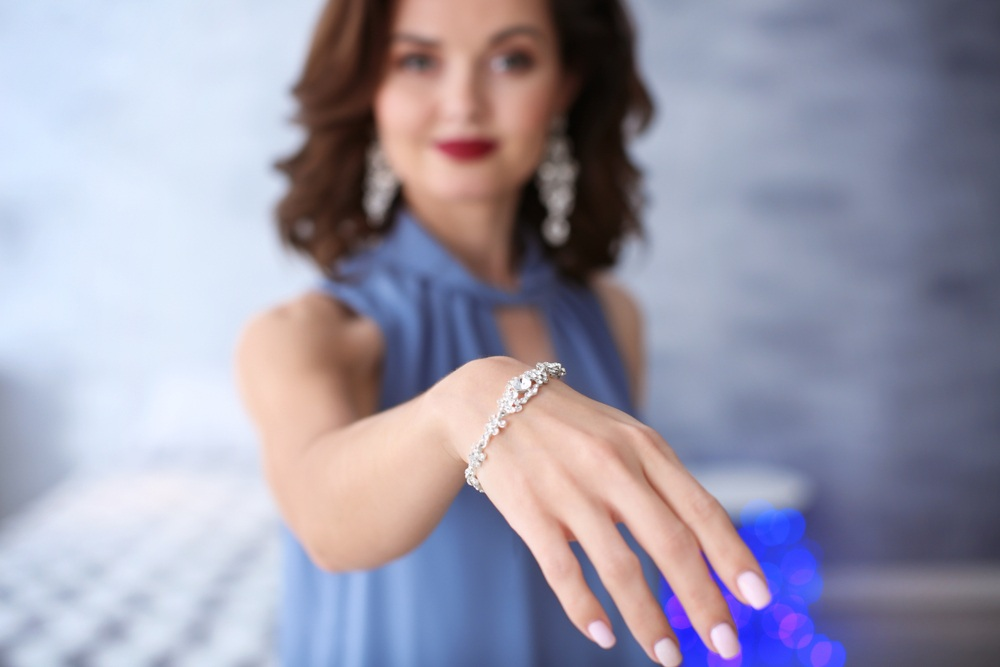 woman-showing-her-beautiful-Diamond-bracelet